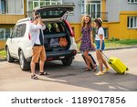 one man and two women loading... | Shutterstock . vector #1189017856
