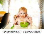 little baby eating spaghetti... | Shutterstock . vector #1189039006
