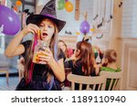 wizard suit. dark haired funny... | Shutterstock . vector #1189110940