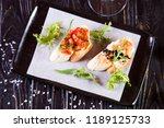 bruschetta with black caviar... | Shutterstock . vector #1189125733