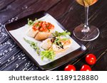 bruschetta with black caviar... | Shutterstock . vector #1189128880