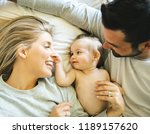family on bed with his baby on... | Shutterstock . vector #1189157620