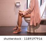 using toilet. woman in bath... | Shutterstock . vector #1189197916