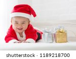 asian baby boy in santa claus... | Shutterstock . vector #1189218700