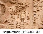 tire track on the sand | Shutterstock . vector #1189361230