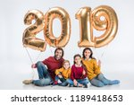 happy family holding sign 2019... | Shutterstock . vector #1189418653