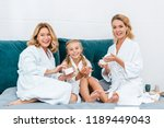laughing three generations of... | Shutterstock . vector #1189449043