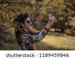 beautiful young female outdoors ... | Shutterstock . vector #1189459846