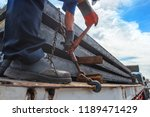 workers driver of the trailer... | Shutterstock . vector #1189471429