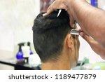 the hairdresser makes stylish... | Shutterstock . vector #1189477879