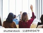 business woman raising hand for ... | Shutterstock . vector #1189493479