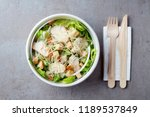 caesar salad in paper bowl with ... | Shutterstock . vector #1189537849