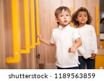 multiethnic kids standing in... | Shutterstock . vector #1189563859
