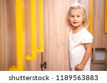 adorable kid standing near open ... | Shutterstock . vector #1189563883