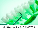 dentist cleaning teeth with...   Shutterstock . vector #1189608793