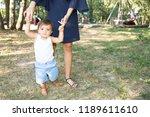 learn to walk son child boy in... | Shutterstock . vector #1189611610