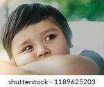 Soft Focus Of Sad Kid Sitting...