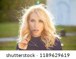 young blonde woman with a... | Shutterstock . vector #1189629619