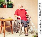 senior adult in a wheelchair ... | Shutterstock . vector #1189671793