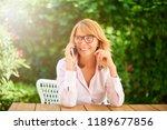 portrait of smiling mature... | Shutterstock . vector #1189677856