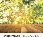wood table and abstract blur... | Shutterstock . vector #1189730173