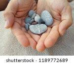 handful of stones in hands ... | Shutterstock . vector #1189772689