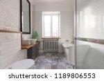 white beautiful attic bathroom... | Shutterstock . vector #1189806553