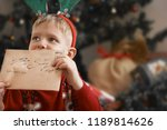 little boy with christmas gifts | Shutterstock . vector #1189814626