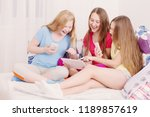 happy girls with smartphone and ... | Shutterstock . vector #1189857619