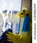 female hand in yellow gloves... | Shutterstock . vector #1189880299