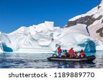 boat full of tourists explore... | Shutterstock . vector #1189889770