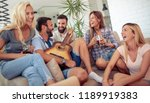happy friends playing guitar... | Shutterstock . vector #1189919383