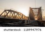 a railway bridge in the morning ... | Shutterstock . vector #1189947976