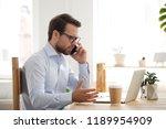 confident serious businessman... | Shutterstock . vector #1189954909