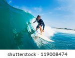 surfer riding large blue ocean... | Shutterstock . vector #119008474