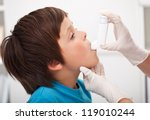 Boy with respiratory system illness receiving help using an inhaler - stock photo