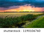 dramatic sky over agriculture... | Shutterstock . vector #1190106760