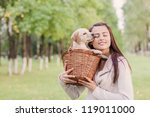 girl with her dog resting... | Shutterstock . vector #119011000