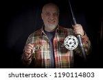 gray haired bearded fisherman... | Shutterstock . vector #1190114803