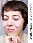 portrait of a girl blinking... | Shutterstock . vector #1190115970