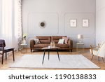 coffee table with vase and mug... | Shutterstock . vector #1190138833