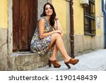happy young woman with blue... | Shutterstock . vector #1190148439
