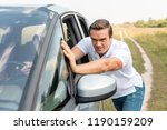 handsome man pushing his broken ... | Shutterstock . vector #1190159209