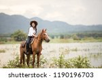 young woman with her horse in... | Shutterstock . vector #1190196703