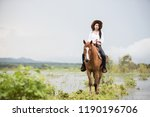 young woman with her horse in... | Shutterstock . vector #1190196706
