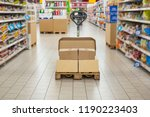 pallet truck with carton boxes... | Shutterstock . vector #1190223403