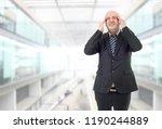 businessman in a suit gestures... | Shutterstock . vector #1190244889