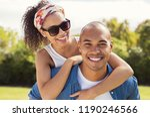 boyfriend giving piggyback to... | Shutterstock . vector #1190246566