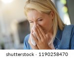 middle aged woman with allergy... | Shutterstock . vector #1190258470