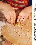 child hands cutting cookies... | Shutterstock . vector #119029618